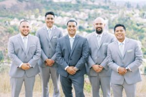 groom and groomsmen photos looking at the camera with their tux