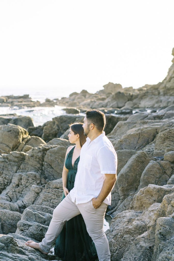 Crescent Bay Engagement Session couple looking off to the distance while at the beach Lizzy_Jacobb